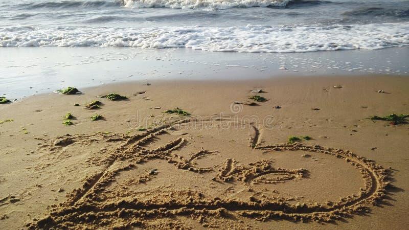 Meddelande i sanden arkivfoto
