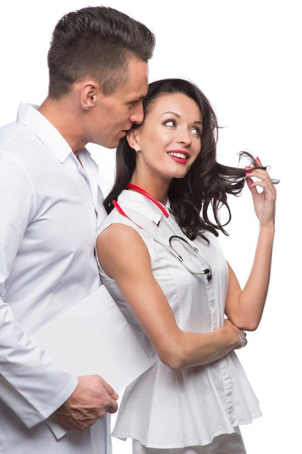 Mededeling van mannelijke en vrouwelijke artsen stock fotografie