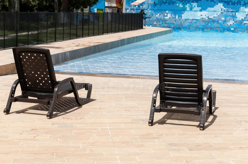 Medellin, Antioquia/Colombia; mayo 23 de 2019: pool chairs by the pool in the recreational water park royalty free stock photos