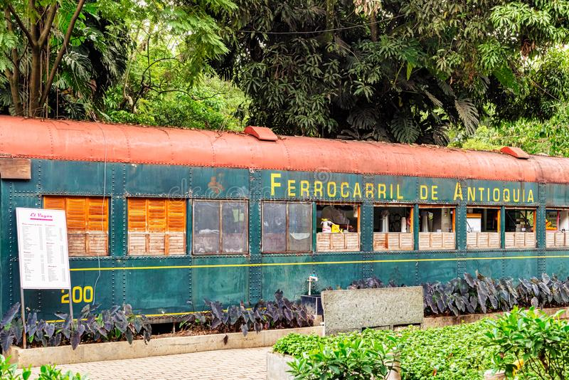 Eatery in old train wagon located at Botanical garden in Medellin, Colombia. Medellin, Colombia, March 24, 2018: Fast food place located in old train wagon royalty free stock image