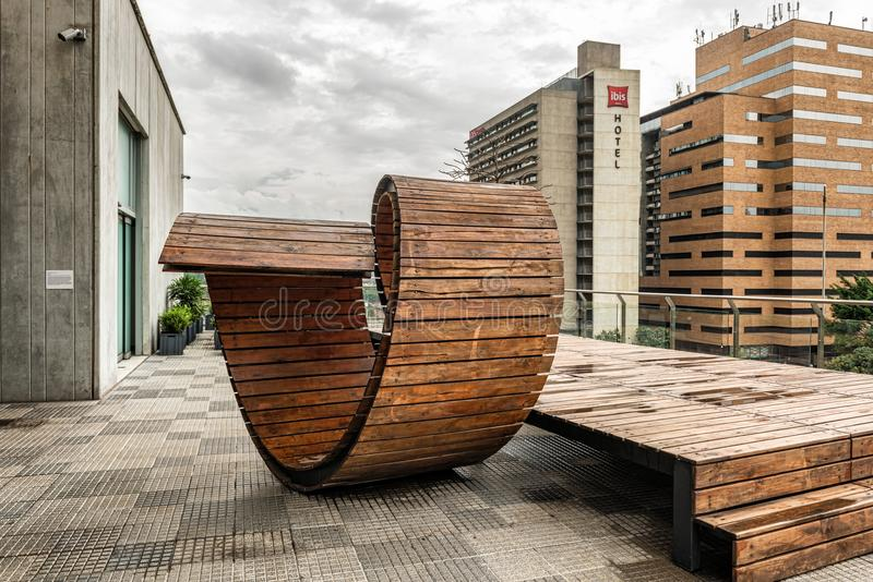 Terrace in Museum of modern art building in Medellin, Colombia. Medellin, Colombia - March 29, 2018: Futuristic wooden composition on the terrace in the Museum royalty free stock photography