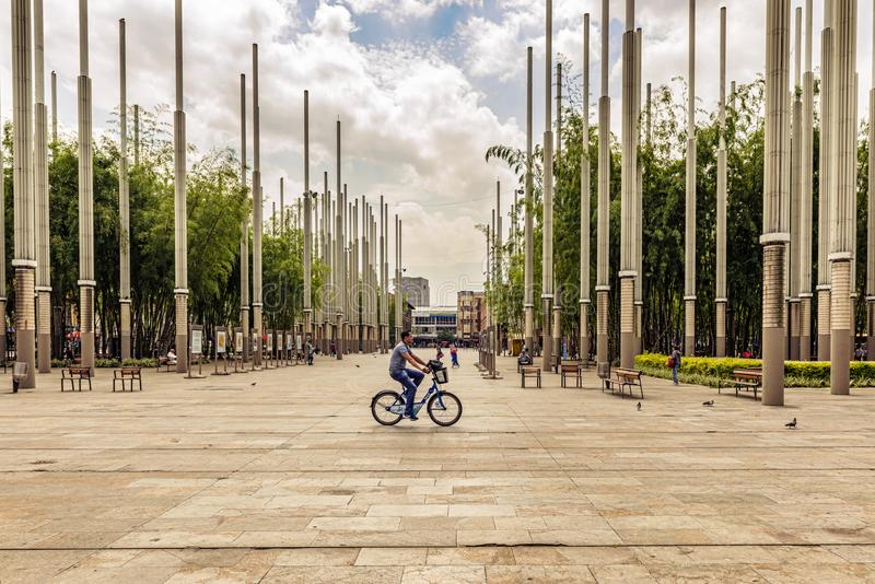 Parque de las luces or Park of Lights in Cisneros Square, Medellin, Colombia. Medellin, Colombia - March 26, 2018: Man riding bicycle in Parque de las luces or stock image
