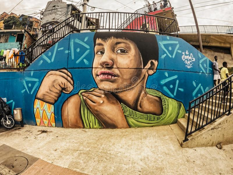 Street art graffiti on a wall in the street of Medellin, Colombia. Medellin, Colombia - March 28, 2018: Street art graffiti on a wall in area called Comuna 13 royalty free stock images