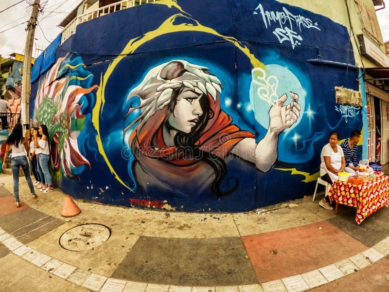 Street art graffiti on a wall in the street of Medellin, Colombia. Medellin, Colombia - March 28, 2018: Street art graffiti on a wall in area called Comuna 13 stock photos