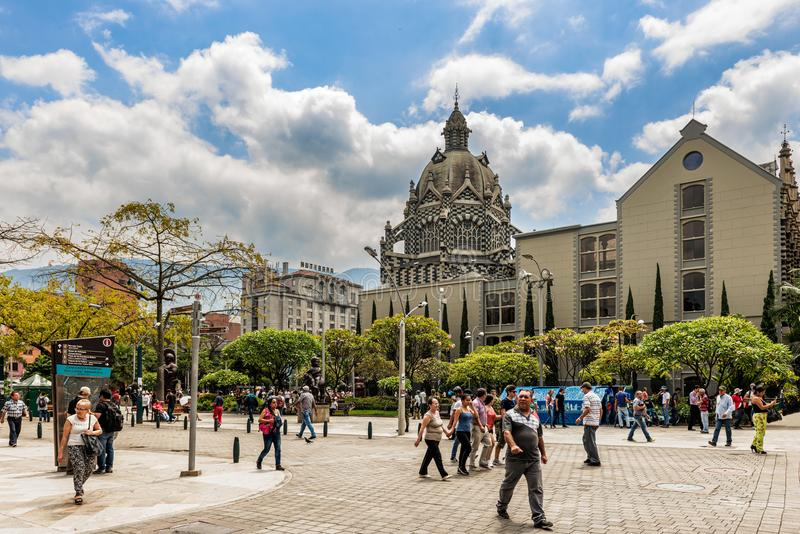 Palace of Culture Rafael Uribe Uribe and Coltejer Building symbols of the city. Medellin, Colombia - March 26, 2018: Tourists walking at Botero Plaza in Medellin stock photos