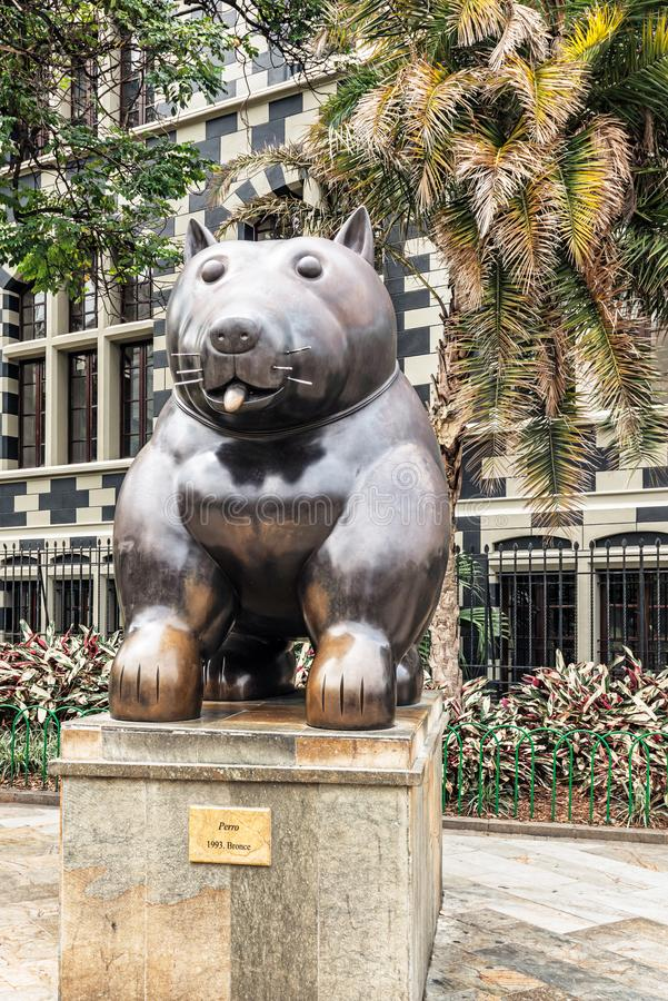 Botero sculptures located at Botero sculptures square in Medellin, Colombia. Medellin, Colombia, March 24, 2018: Tourists walking by Botero sculptures located stock photos