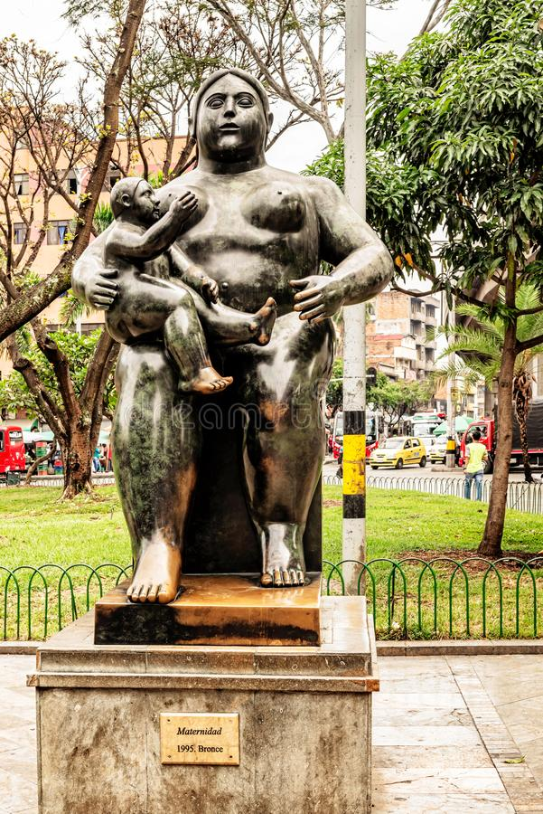 Botero sculptures located at Botero sculptures square in Medellin, Colombia. Medellin, Colombia, March 24, 2018: Tourists walking by Botero sculptures located royalty free stock photography