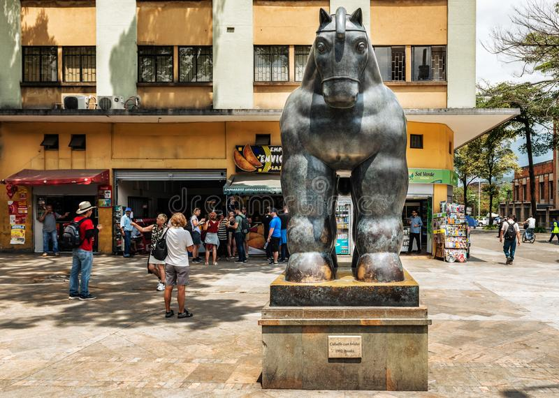 Botero sculptures located in Medellin, Colombia. Medellin, Colombia, March 24, 2018: Tourists walking by Botero sculptures located in Medellin, Colombia. Botero stock photography