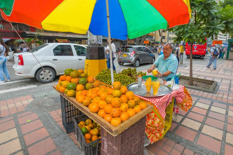Preparation of ready to eat fruit on the street stock images