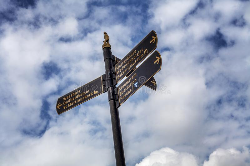 Medemblik, Holland, 08/21/2015: Direction signs on a background of blue cloudy sky. Close-up stock image