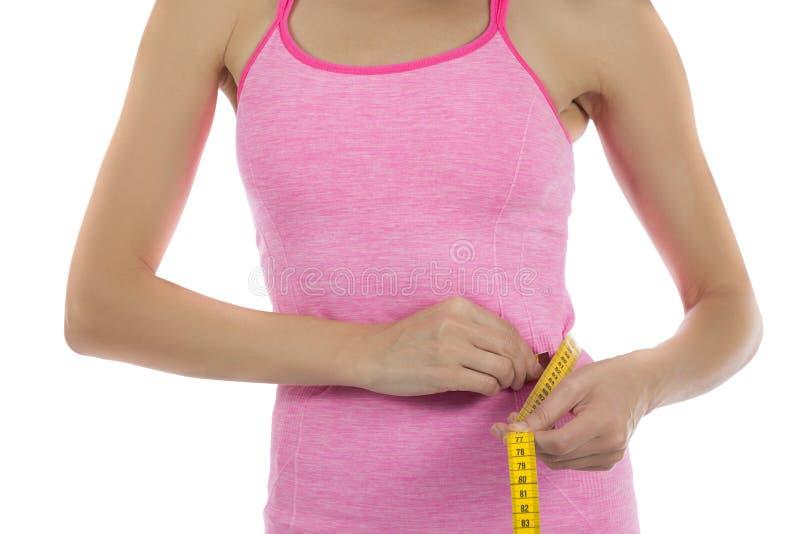 Medição da perda de peso da mulher fotografia de stock