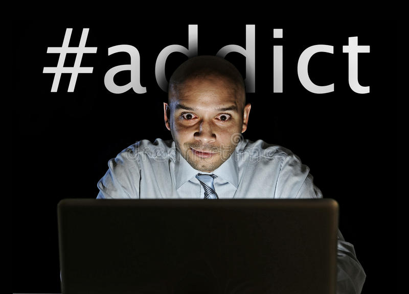 Media addict man late night sitting at computer on internet web social network addiction. Young media addict man late night sitting at computer laptop isolated royalty free stock photo