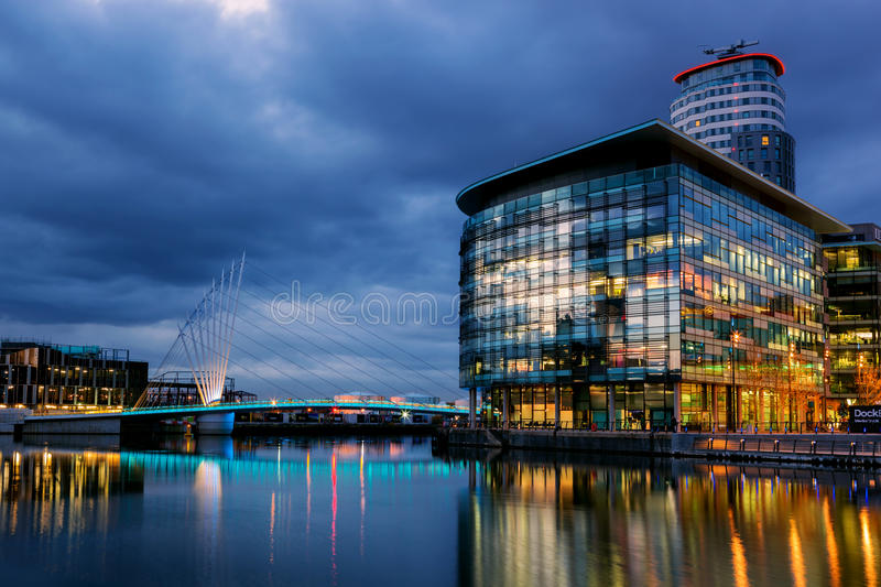 Media City full view. Foot bridge linking BBC media city and Imperial War museum at the Salford Quays, Manchester stock photography