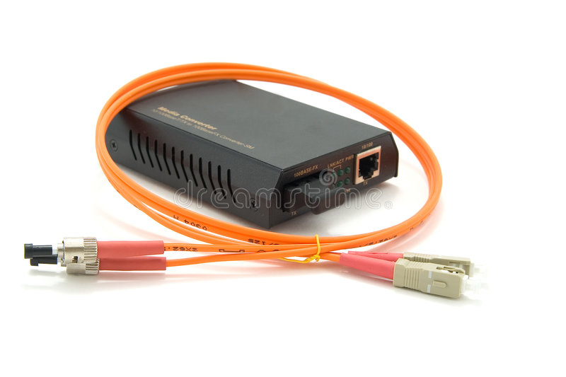 Media converter and fiber optic cord. royalty free stock photography