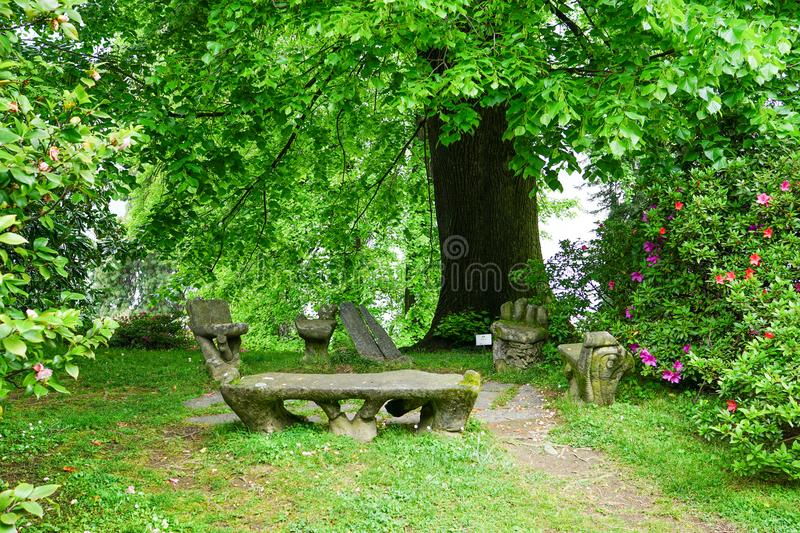 Media corner for rest. A fragment of the gardens of Villa Melzi. stock photography