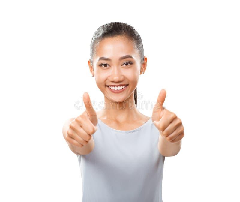 Media foto del cuerpo de la muchacha asiática de la alegría que da el pulgar para arriba foto de archivo libre de regalías