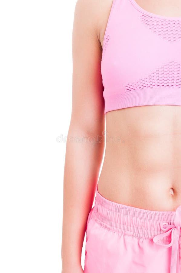 Media imagen del cuerpo femenino del instructor de la aptitud imagenes de archivo