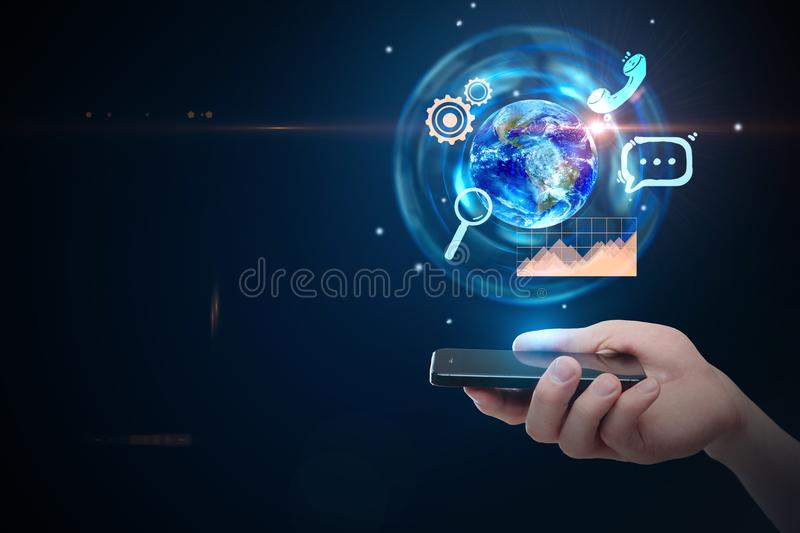 Media and interface concept. Hand holding smartphone with glowing business hologram. Media and interface concept. 3D Rendering. Elements of this image furnished stock photo