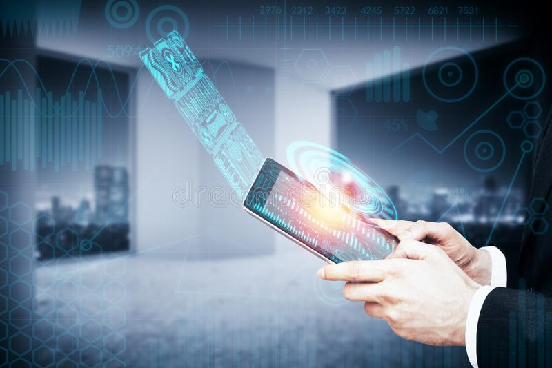 Media and interface concept. Side view of businessman hands holding tablet with creative business hologram on blurry interior background. Media and interface royalty free stock photography