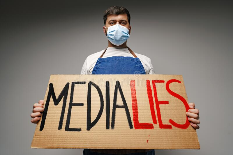 media-lies-painted-placard-hands-protester-man-media-lies-painted-placard-hands-protester-man-standing-against-205095886.jpg
