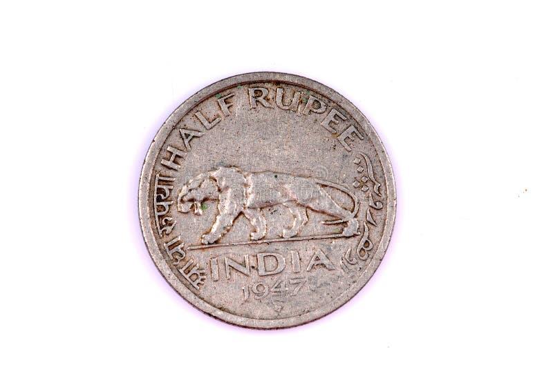 Media moneda vieja de la rupia fotografía de archivo libre de regalías