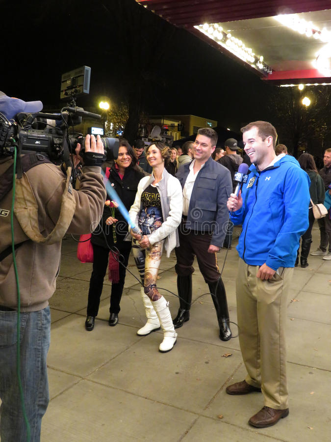 Media at the Movie Theatre. Photo of tv news reporter being taped at the uptown movie theatre in washington dc. The theatre is showing the star wars episode 7 royalty free stock photo