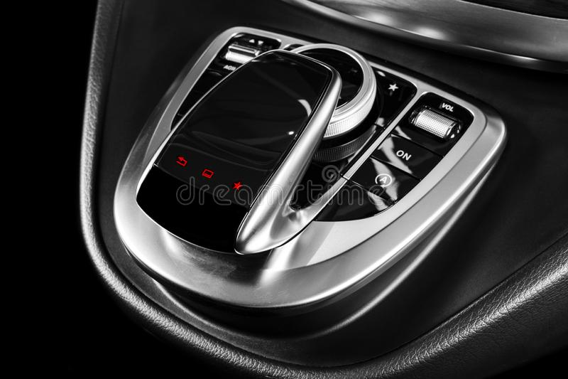 Media and navigation control buttons of a Modern car. Car interior details. Brown leather interior with stitching of the luxury mo. Dern car. Modern car interior stock photos
