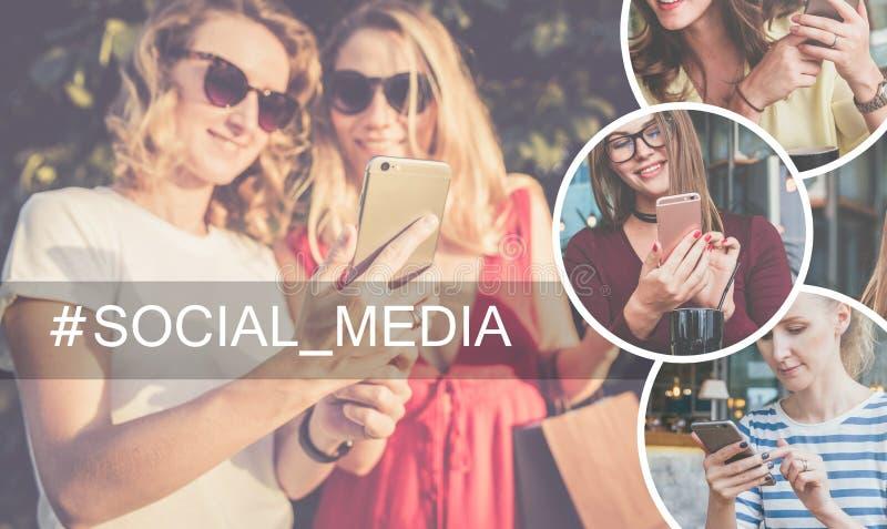 Media sociales Árbol en campo Primer del smarfon en las manos de las mujeres jovenes que se colocan al aire libre imágenes de archivo libres de regalías