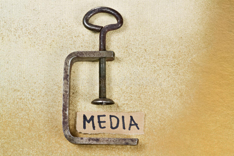 Media. Word Media under pressure of clamp on yellow background royalty free stock images