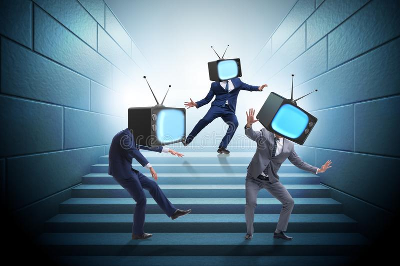 The media zombie concept with man and tv set instead of head. Media zombie concept with man and tv set instead of head stock image