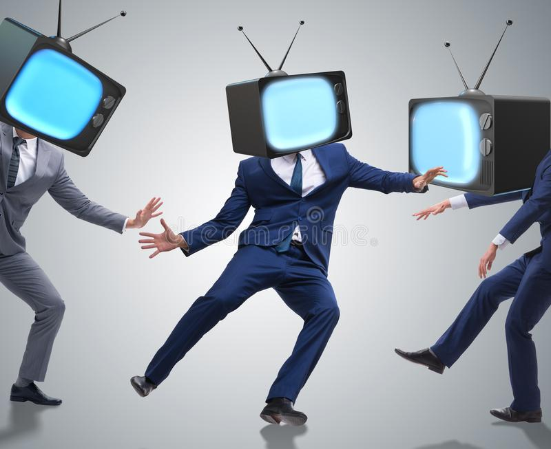 Media zombie concept with man and tv set instead of head royalty free stock photos