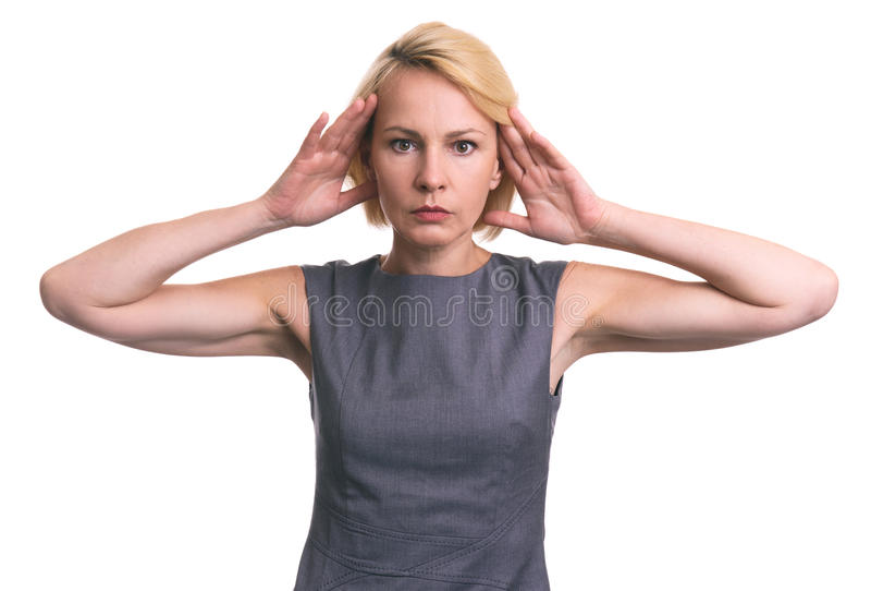 Mediados de mujer de negocios envejecida que tiene dolor de cabeza foto de archivo