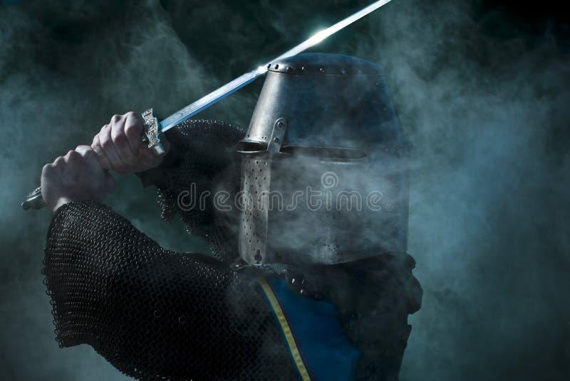 Mediaeval knight. With sword and helmet stock photos