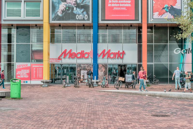 Mediamarkt Amsterdam Arena, consumer electronics, retail off online shopping, TV, mobilephone, computer, logo, people infront of. Amsterdam, Arena boulevard, The royalty free stock image