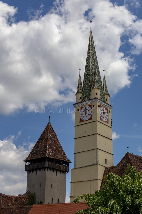 Bell and Trumpet towers in Medias, Romania stock images