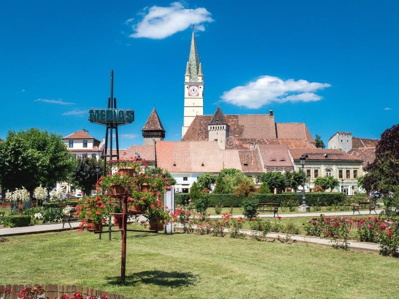 Medias Romania town square and Saxon Cathedral clock tower. Old Saxon village in Transylvania stock photo