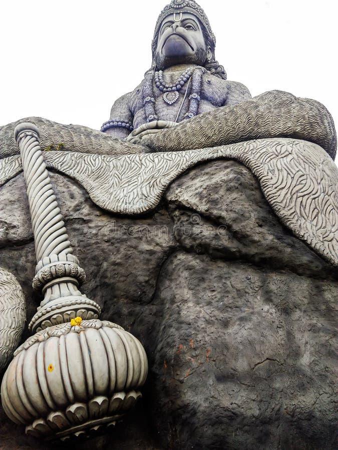 Mediating hanuman rock statue bangalore. Mediating hanuman statue made in rock  in India Karnataka Bangalore royalty free stock photo