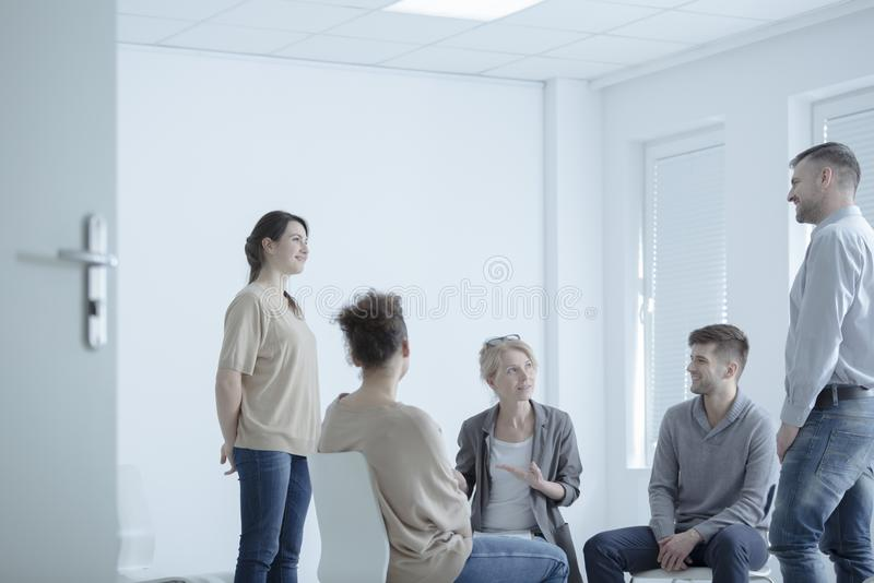 Mediator trying to reconcile people. Mediator trying to reconcile two young people who are married at a couples meeting stock images