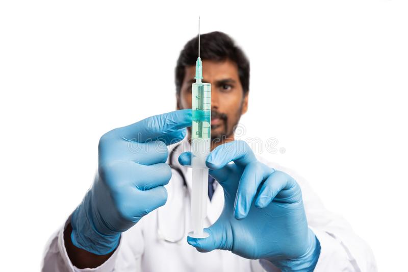 Medic checking syringe with vaccine royalty free stock photo