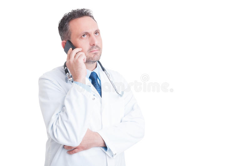 Medic or doctor making phone consultation isolated on white. Copy and advertising space royalty free stock images