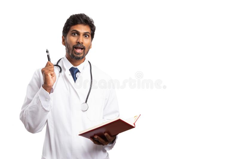 Medic having great idea while holding agenda royalty free stock images