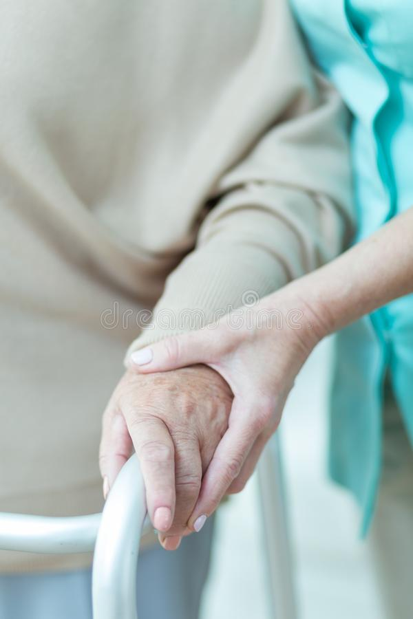 Medic holding patients hand stock photography