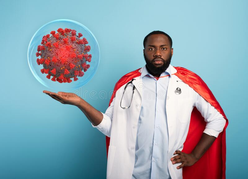 Medic like a superhero found a solution toblock the pandemic of covid19 coronavirus. Blue background royalty free stock image