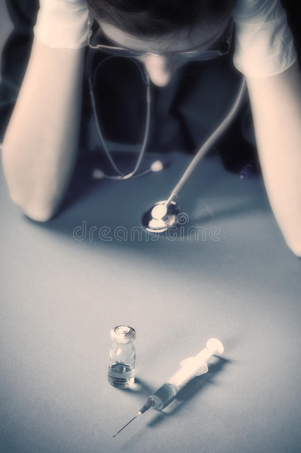 Medic with medical dilemma royalty free stock images