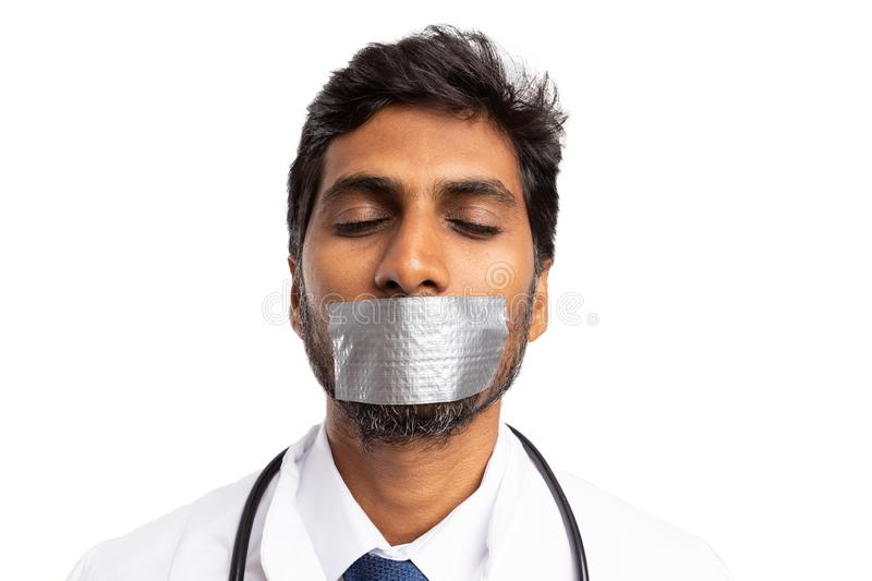Medic silenced with mouth being taped royalty free stock photos