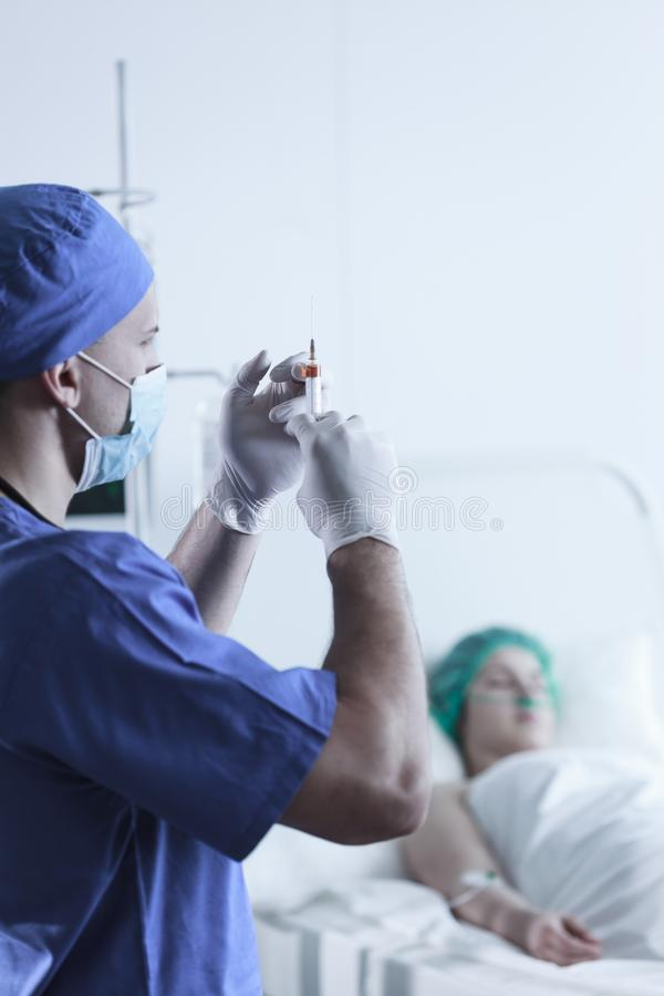 Medic with syringe stock photography