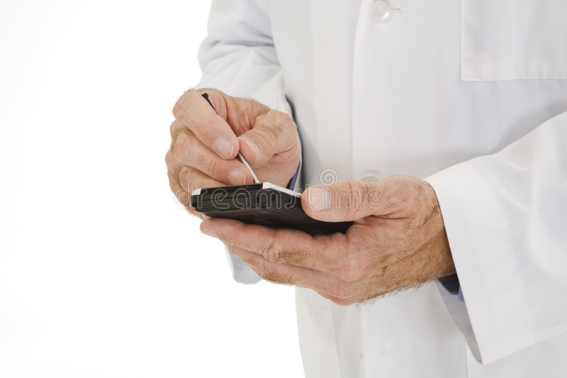 Caucasian doctor wearing a white lab coat using PDA royalty free stock photos