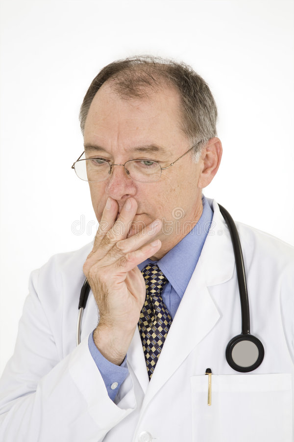 Caucasian doctor with a receding hairline wearing a white lab coat royalty free stock images