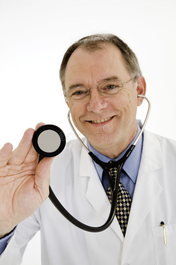Caucasian male doctor or nurse wearing a lab coat with a stethoscope royalty free stock photo