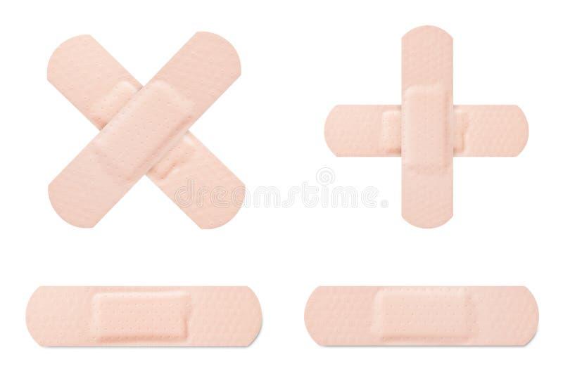 Medical adhesive bandage. Crossed and stripe royalty free stock photos
